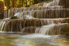 Beautiful stream waterfalls in deep forest jungleDeep forest stream waterfalls in national park of Thailand Stock Photo