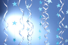 Beautiful streamers and stars. On blue background stock photos