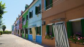 Beautiful street with brightly colored houses, famous Burano island architecture. Stock footage stock video