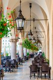 Beautiful street cafe, located in the arch of shopping arcades i. N the center of Krakow in the square Royalty Free Stock Photography