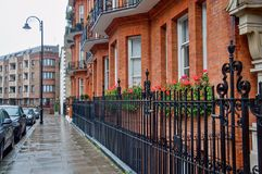 Beautiful street in Kensington, London. A beautiful street Palace Gate in Kensington, London - Great Britain Stock Images