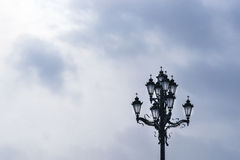 Beautiful street lamp with Christian crosses on the bulbs Royalty Free Stock Photography