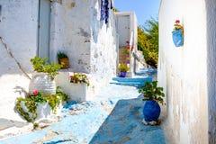Beautiful street in old traditional Greek cycladic village Plaka Stock Image