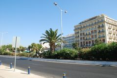 Beautiful street with palm trees and expensive hotels in Crete stock image