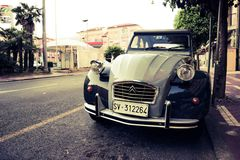 Beautiful street in Paris. Street in Paris with typical car parked on side of the road royalty free stock photo