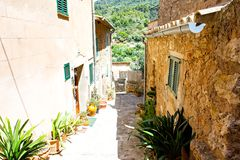 Beautiful street in Valldemossa with traditional flower decoration, famous old mediterranean village of Majorca. Balearic island Mallorca, Spain Royalty Free Stock Photography