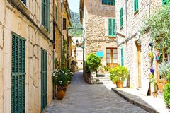Beautiful street in Valldemossa with traditional flower decoration, famous old mediterranean village of Majorca. Balearic island Mallorca, Spain Stock Photography