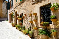 Beautiful street in Valldemossa with traditional flower decoration, famous old mediterranean village of Majorca. Balearic island Mallorca, Spain Stock Images