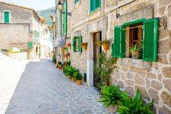 Beautiful street in Valldemossa with traditional flower decoration, famous old mediterranean village of Majorca. Balearic island Mallorca, Spain Royalty Free Stock Image