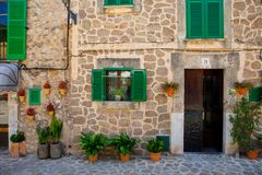 Beautiful street in Valldemossa with traditional flower decoration, famous old mediterranean village of Majorca. Balearic island Mallorca, Spain Royalty Free Stock Images