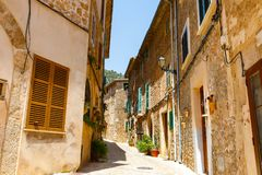 Beautiful street in Valldemossa with traditional flower decoration, famous old mediterranean village of Majorca. Balearic island Mallorca, Spain Royalty Free Stock Photos