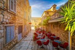 Free Beautiful Street With Flowers In The Hvar Town, Hvar Island, Dalmatia, Croatia. Old Mediterranean Street, Hvar Town. Old Adriatic Stock Photography - 135457492