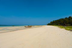 Wide White Sand Beach Five Havelock Island. A beautiful stretch of wide white sand beach at low tide on the tourist destination of Havelock Island of the Andaman Royalty Free Stock Photos