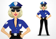 Beautiful strict policewoman holding hands on hips Royalty Free Stock Photos