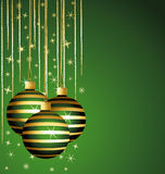 Beautiful striped balls on a green background. Stock Photography