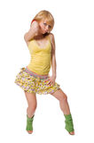Beautiful stripper wearing yellow dress on white b Stock Photo