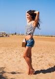 Beautiful strong enjoying woman posing on the beach in blue shor Royalty Free Stock Photos