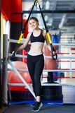 Young athletes girl does exercises at the gym. Sport concept. royalty free stock images