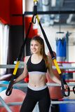Young athletes girl does exercises at the gym. Sport concept. stock image
