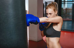 Beautiful strong girl working on her punch Royalty Free Stock Photo