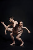 Beautiful strong gymnasts performing together in the studio Stock Photography