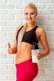 Beautiful strong sportswoman Stock Photos