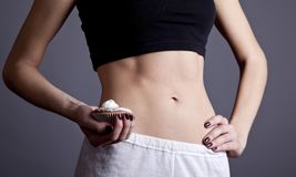Beautiful and strong women's abs with metre. Stock Image