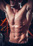 Beautiful and strong young muscular guy. In club Stock Images