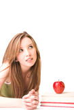 Beautiful studen. T, wiyh books and apples,  thinking Stock Images