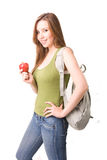 Beautiful studen. T, with bag and apples,  thinking Royalty Free Stock Photography