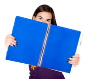 Beautiful student with a blue notebook Stock Images