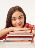 A beautiful student with books. Portrait of a beautiful student with books Royalty Free Stock Images