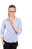 beautiful student/businesswom an with glasses pointing to copy space Royalty Free Stock Photography