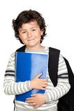 Beautiful student child with heavy backpack Stock Images