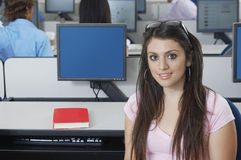 Beautiful Student In Computer Lab. Portrait of beautiful student in computer lab Royalty Free Stock Images