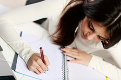 Beautiful student doing her homework Royalty Free Stock Photos
