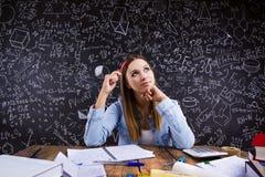 Beautiful student doing homework Stock Images