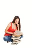 Beautiful student girl with books. Isolated on Royalty Free Stock Image