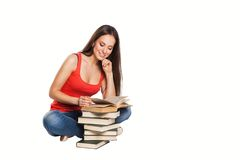 Beautiful student girl with books. Isolated on Royalty Free Stock Photos