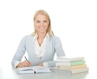 Beautiful student girl doing homework Stock Images