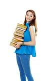 Beautiful student girl holding books. Beautiful smiling student girl holding pile of books Stock Photo