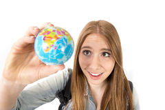 Beautiful student girl holding little world globe in her hand choosing holidays destination in travel tourism concept. Young beautiful student girl holding Stock Photography