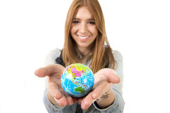 Beautiful student girl holding little world globe in her hand choosing holidays destination in travel tourism concept Stock Photography