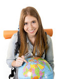 Beautiful student girl holding world globe in her hand choosing holidays destination in travel tourism concept Stock Image