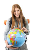 Beautiful student girl holding world globe in her hand choosing holidays destination in travel tourism concept Royalty Free Stock Photo