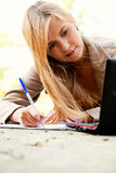 Beautiful student girl with laptop in the park Stock Photos