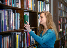 Beautiful student girl in a library Royalty Free Stock Photos