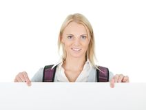Beautiful student girl presenting empty board Stock Photography