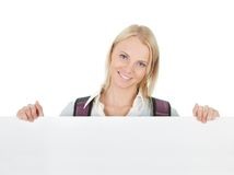 Beautiful student girl presenting empty board Royalty Free Stock Photography