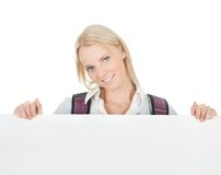 Beautiful student girl presenting empty board Royalty Free Stock Image